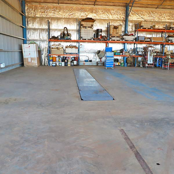 Farm workshop pit design